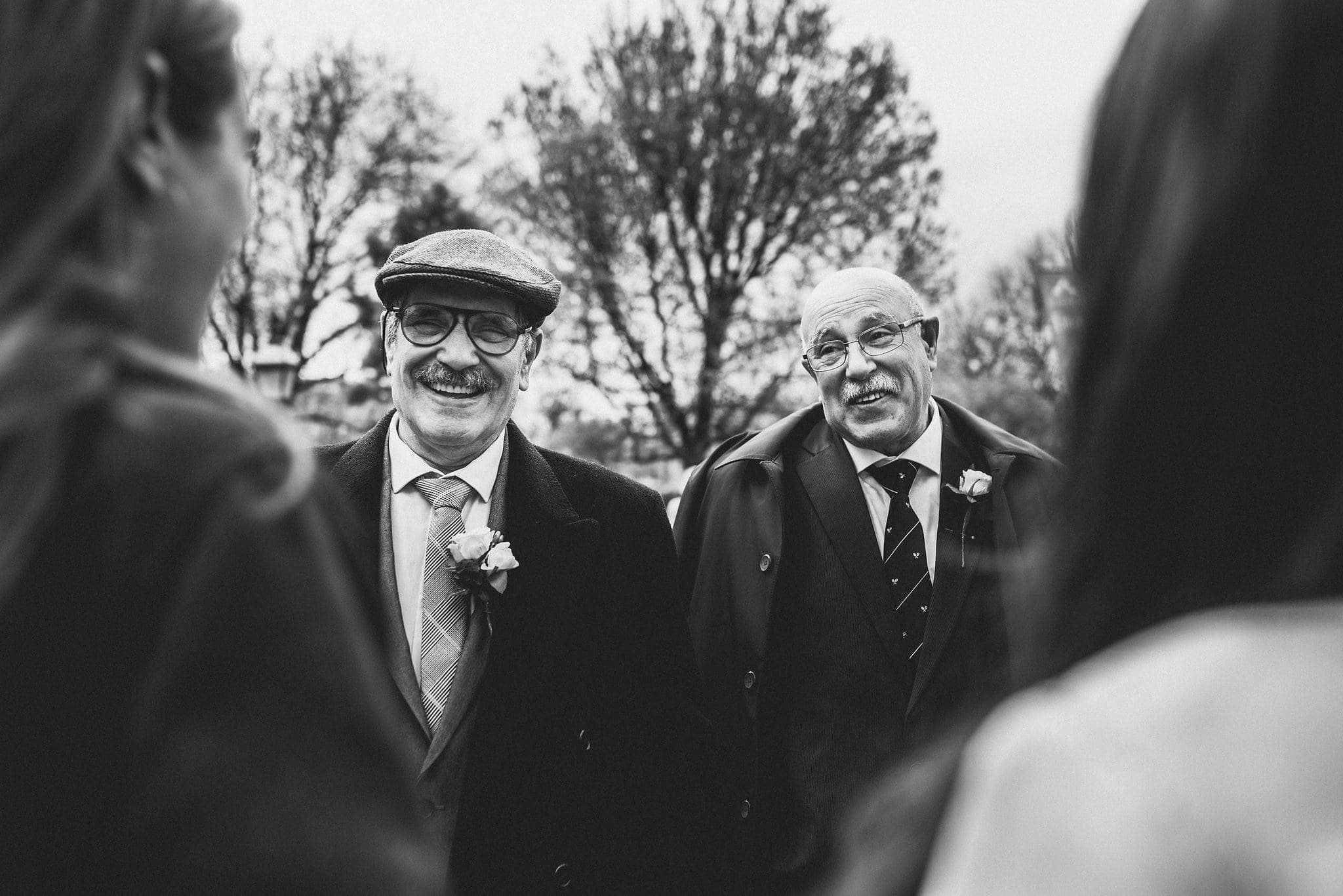 Black and white shot of fathers of the bride or groom