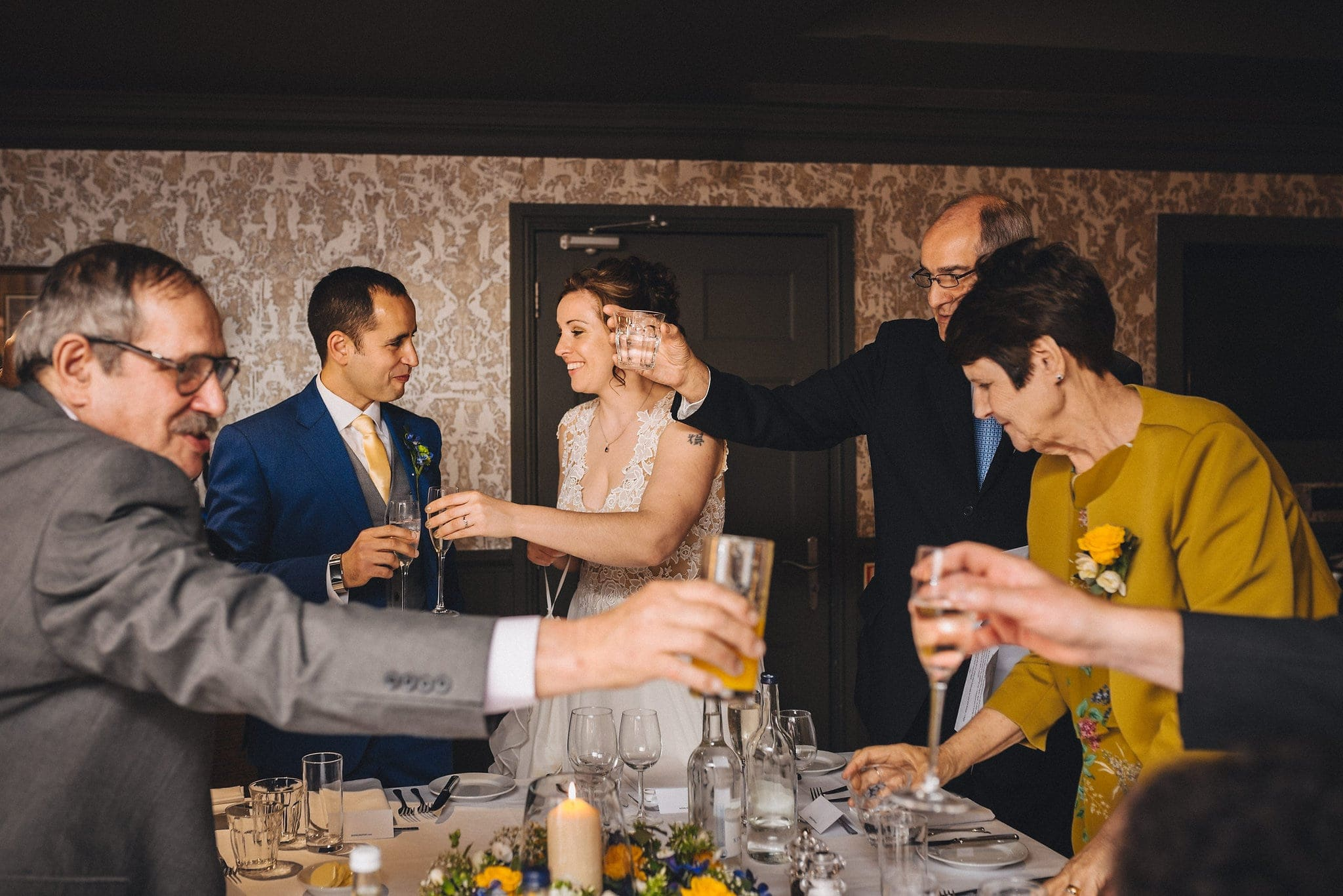 Guests toast bride and groom at wedding reception in Brighton