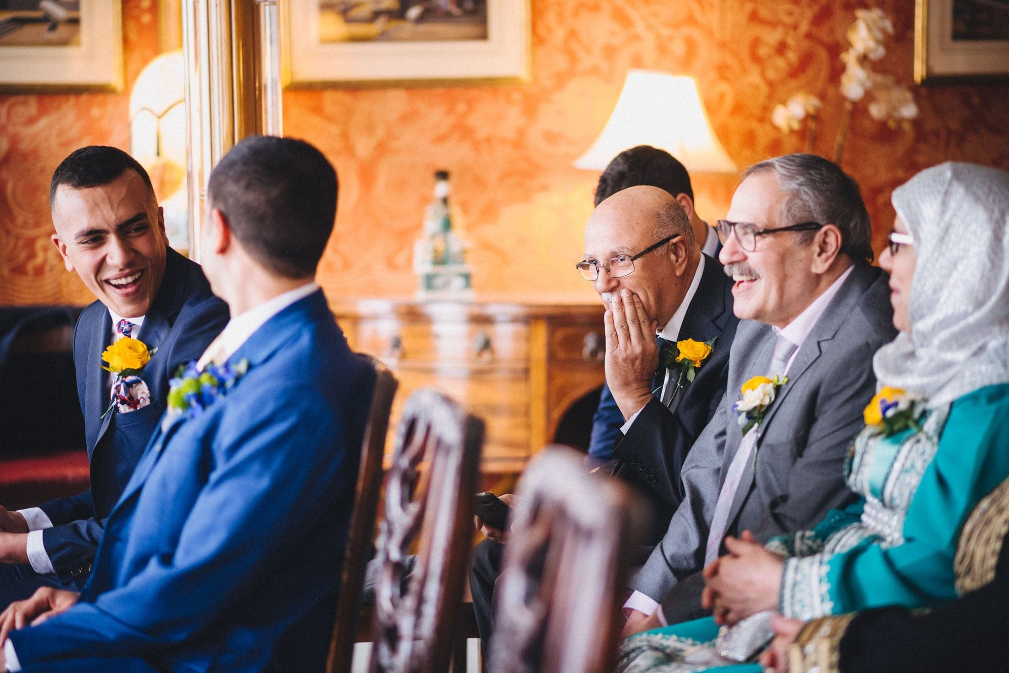 guests laugh together at wedding ceremony in Brighton Royal Pavilion