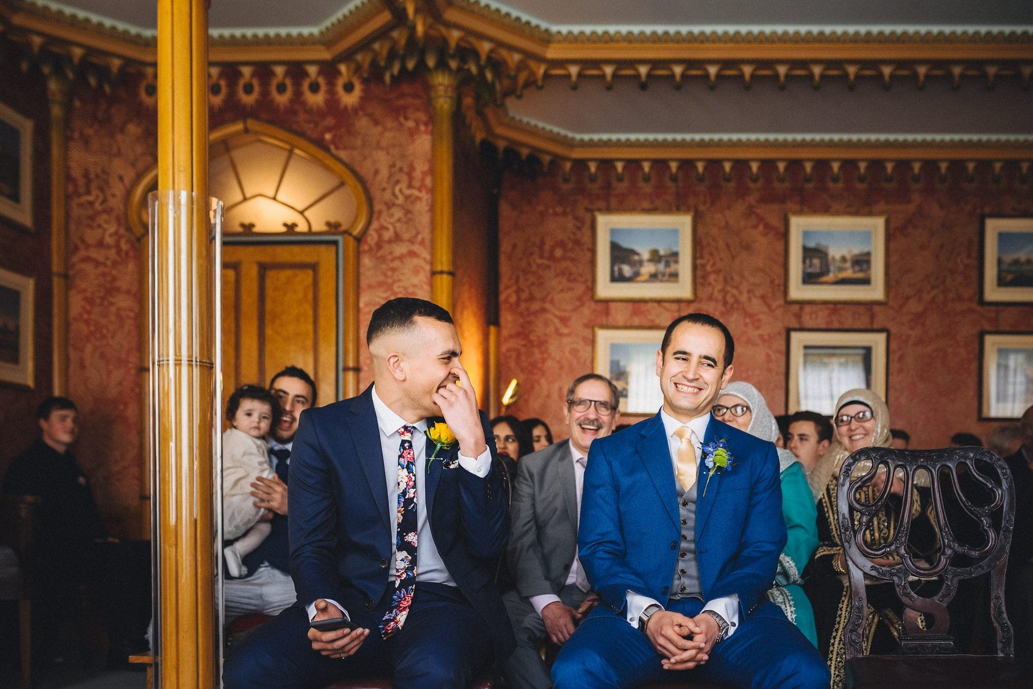 Groom laughs with best man at Brighton Royal Pavilion wedding