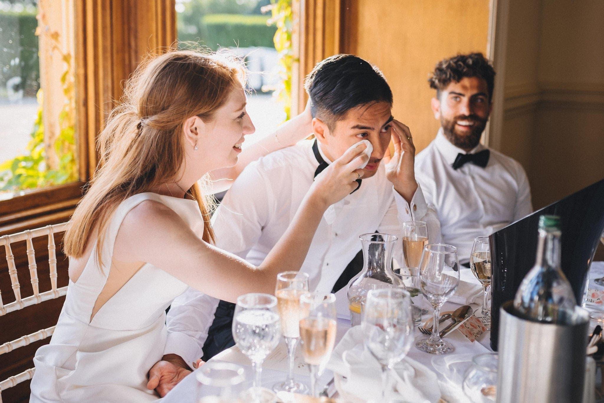Bride wipes groom's eyes during emotional wedding speeches