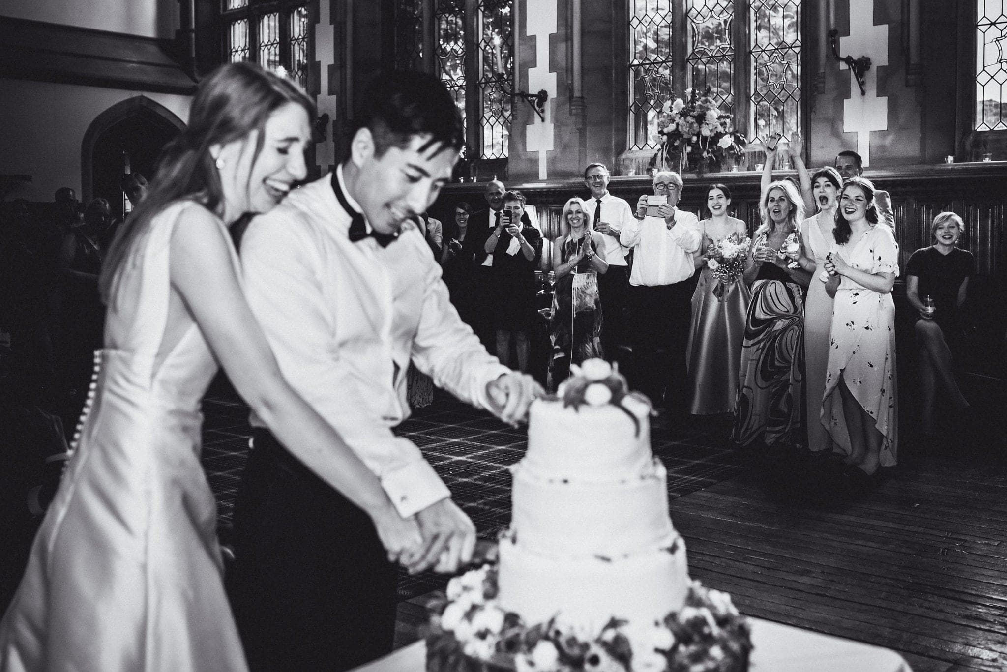 Black and white shot of cake cutting
