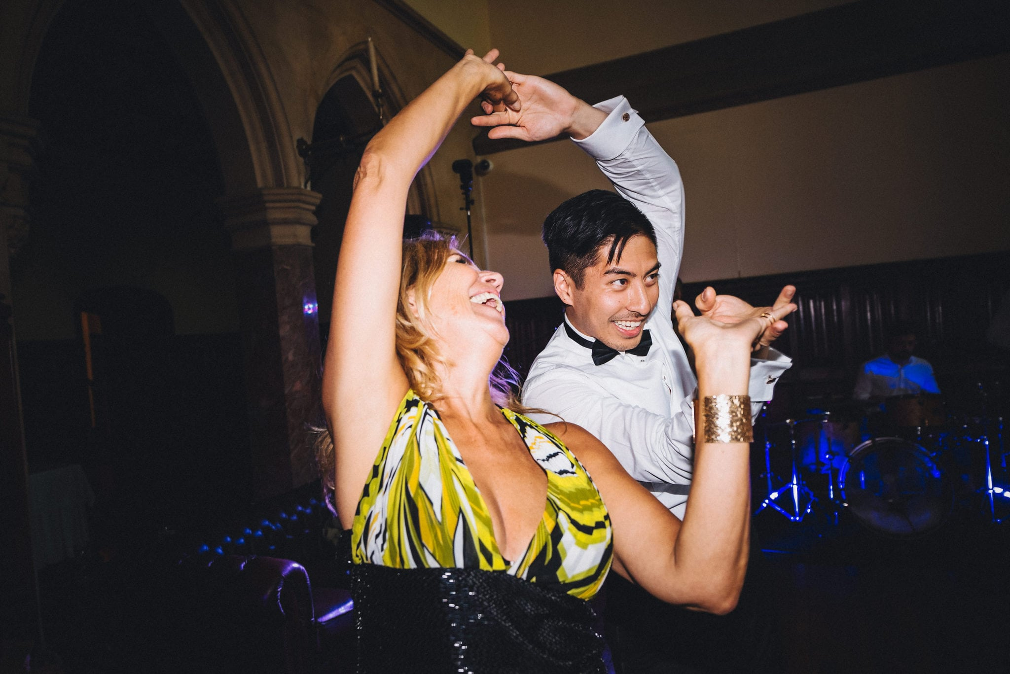 Guests twirl each other on dance floor