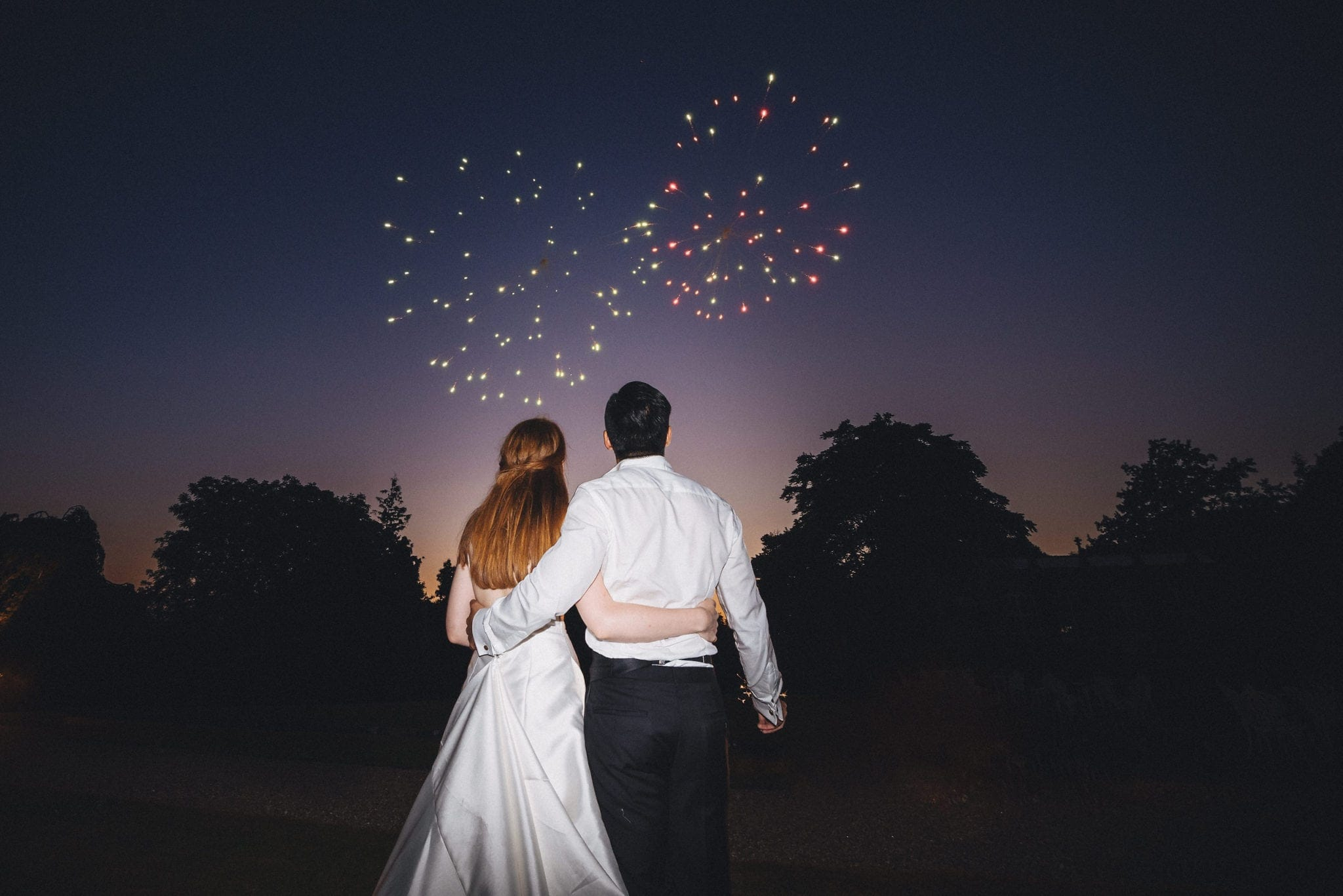 Bride and groom watch fireworks at St Audries Park