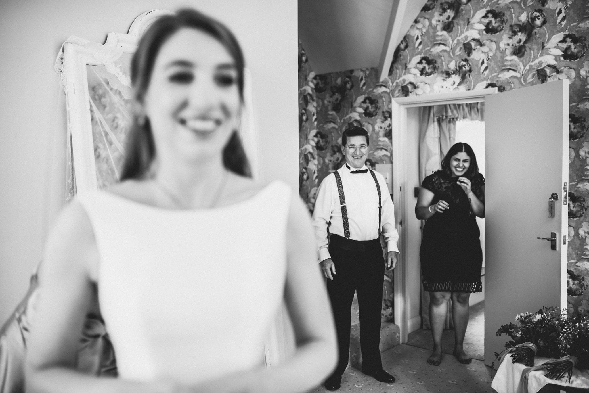 Black and white shot of father of the bride seeing his daughter in her dress for the first time