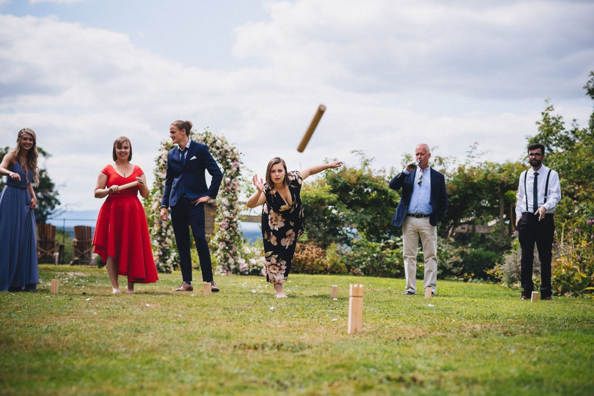 Guests playing a Swedish lawn game, throwing blocks in the grounds of Dewsall Court
