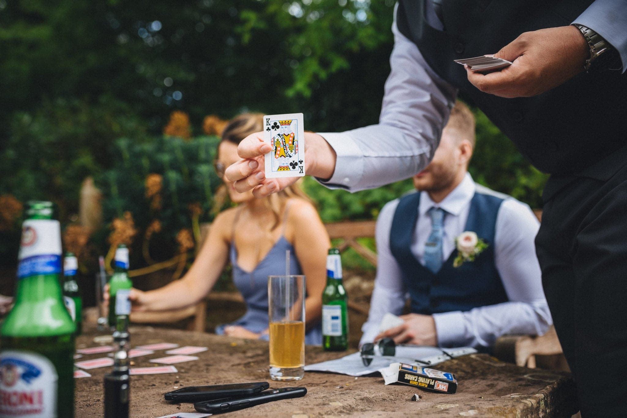 King of clubs shown during drinking game at Dewsall Court wedding