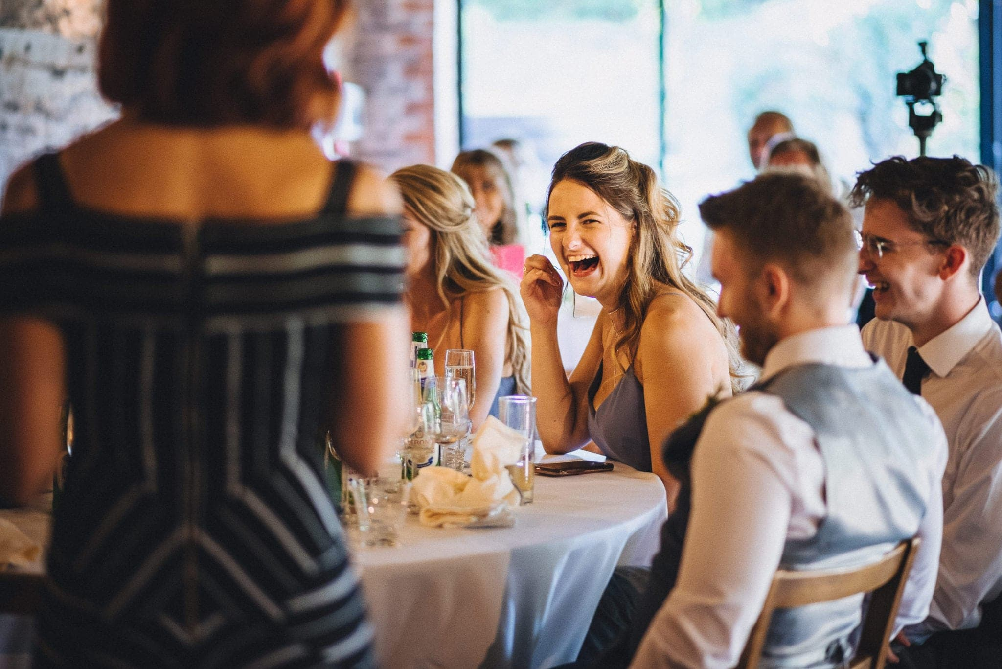 Guest laughs at speeches