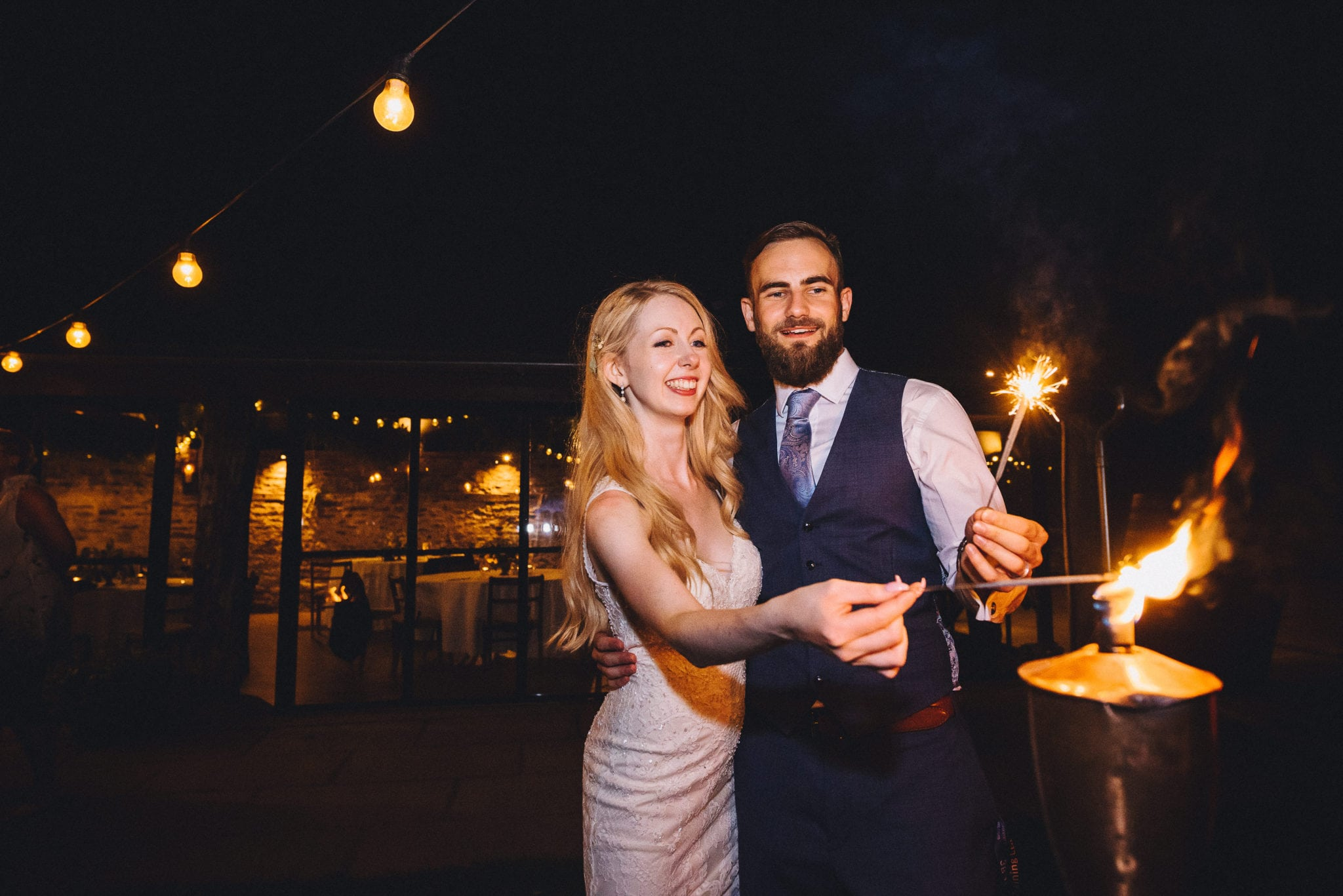 Bride and groom hold sparklers
