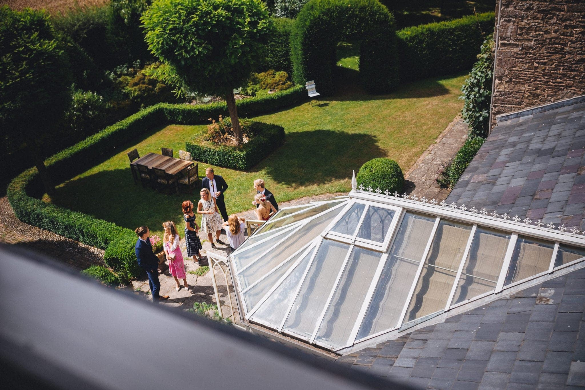 View out over Dewsall Court gardens as guests arrive