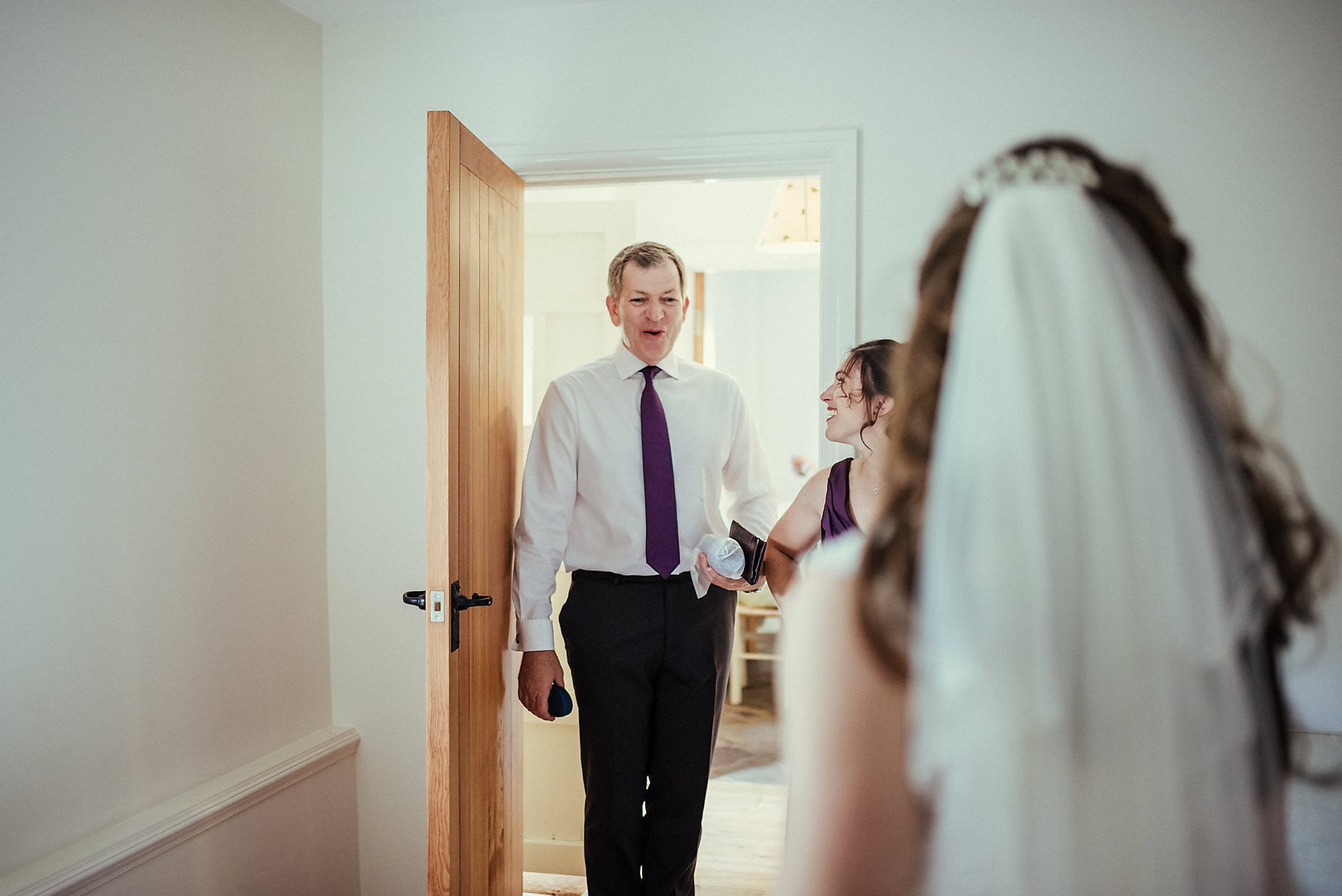 Father of the bride sees his daughter in her dress for the first time