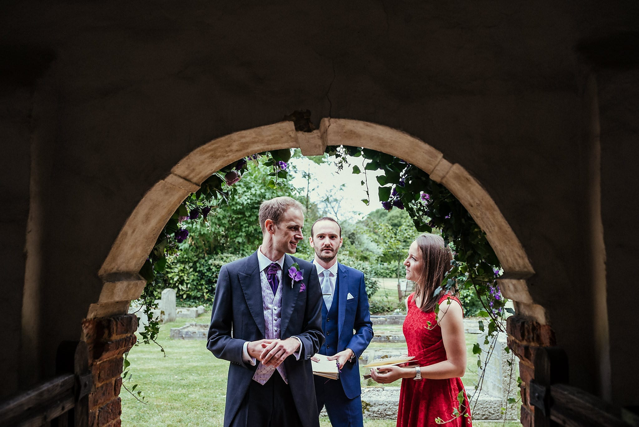 Groom chatting in the church doorway at Dorney Court