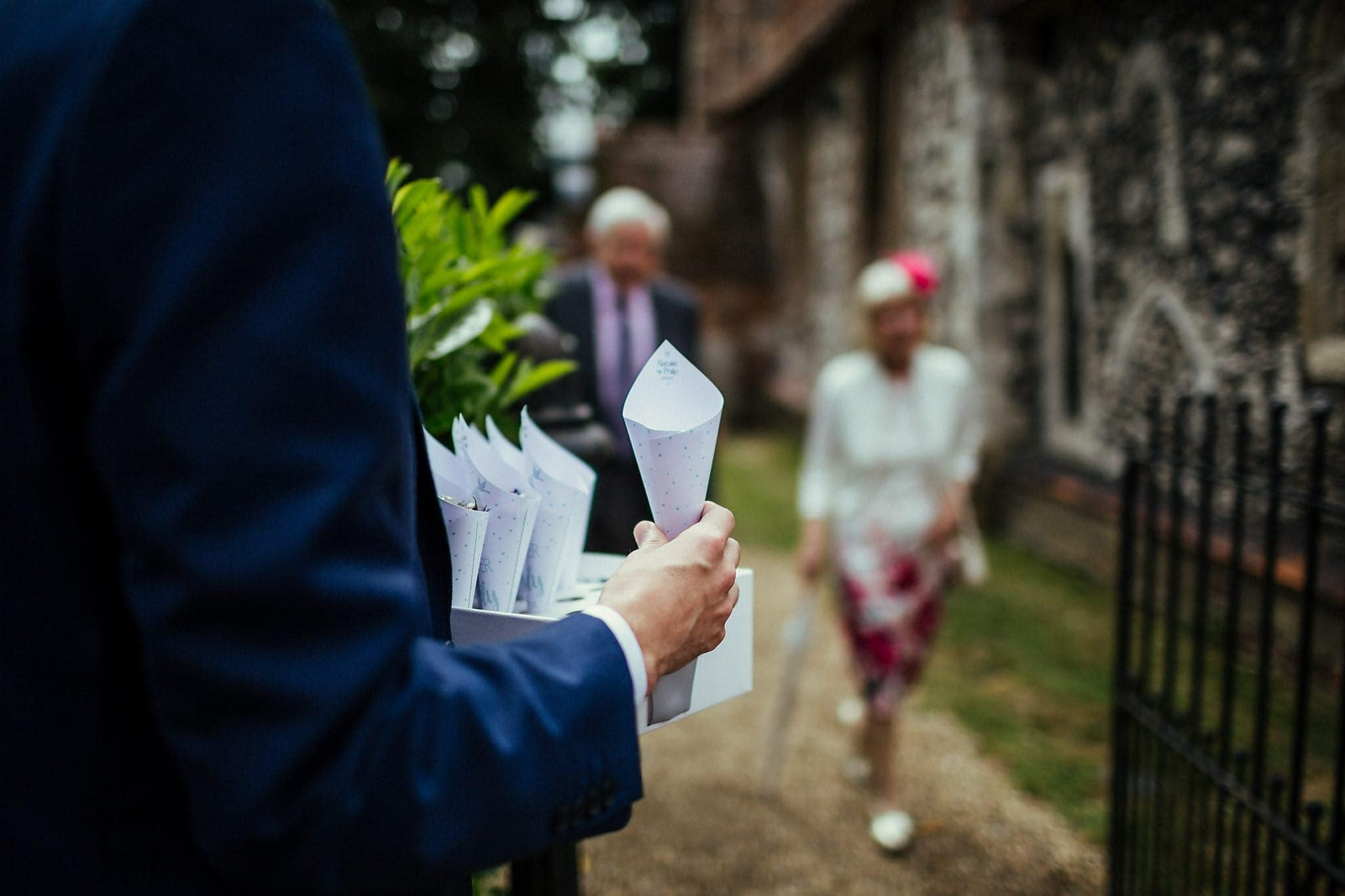Usher holding confetti cones at Dorney Court Church