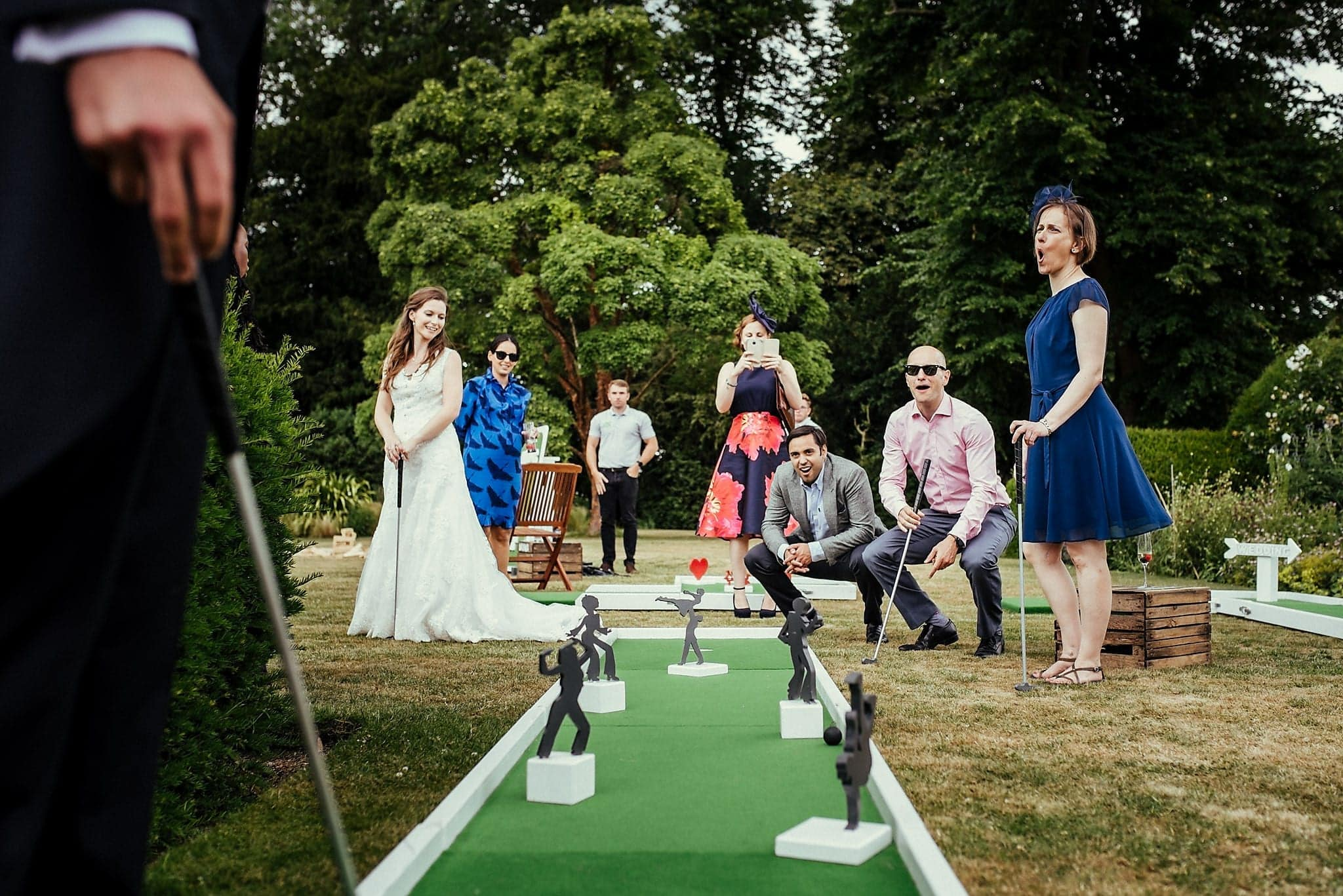 Bride, groom and Wedding guests play mini gold at a Dorney Court Wedding