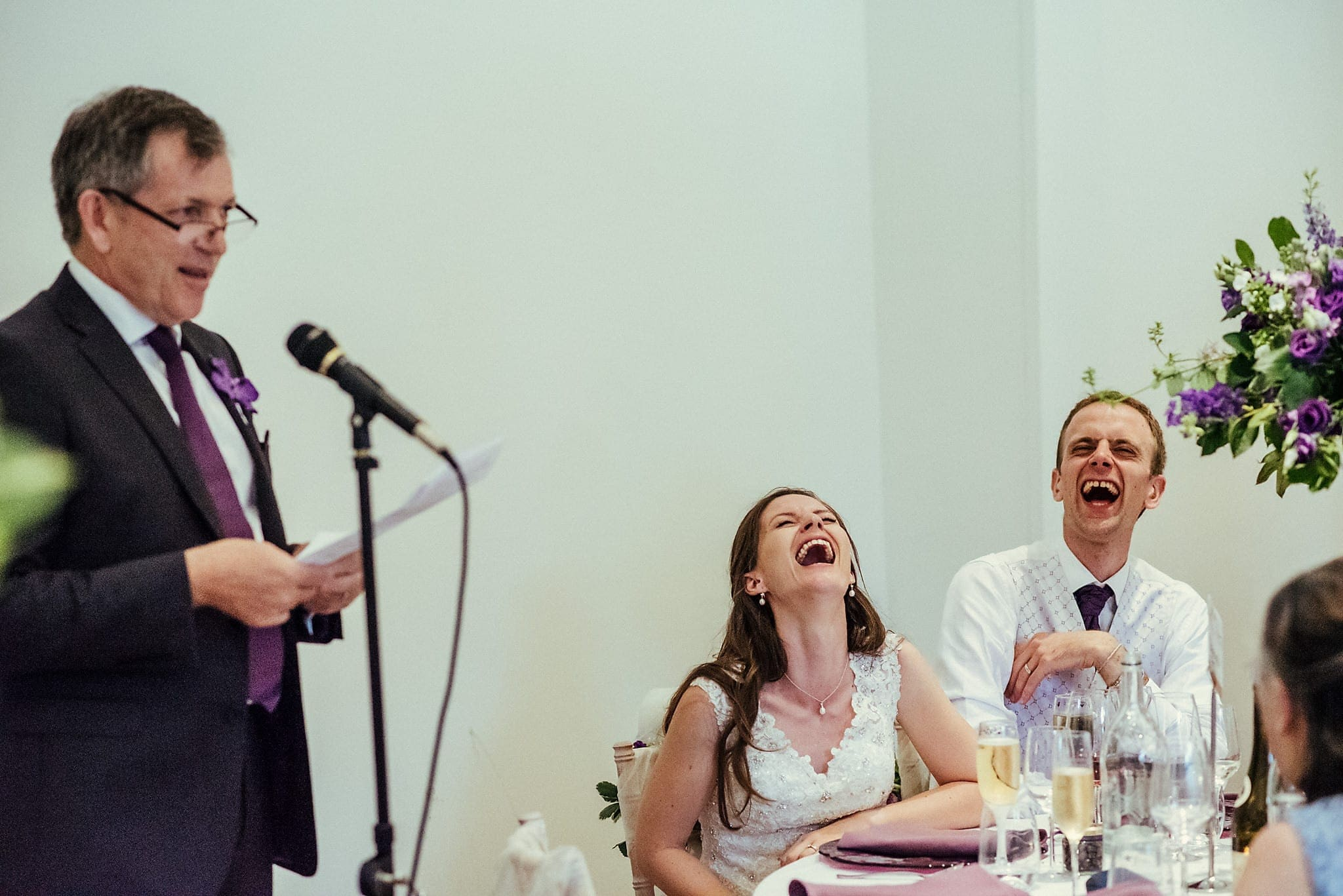 Bride and Groom laughing out loud at their Lovely and Lively Dorney Court Tipi Wedding | Maria Assia Photography