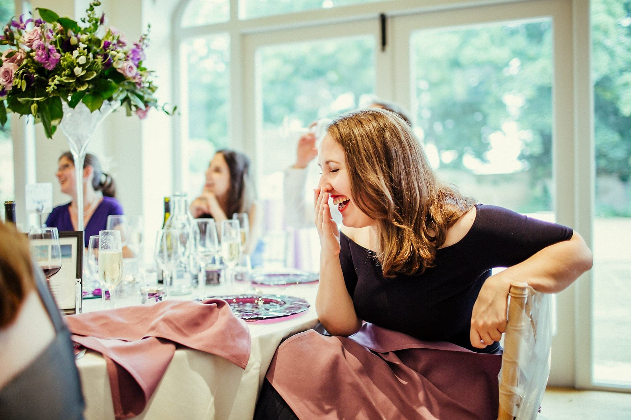 Guest laughs during wedding speeches