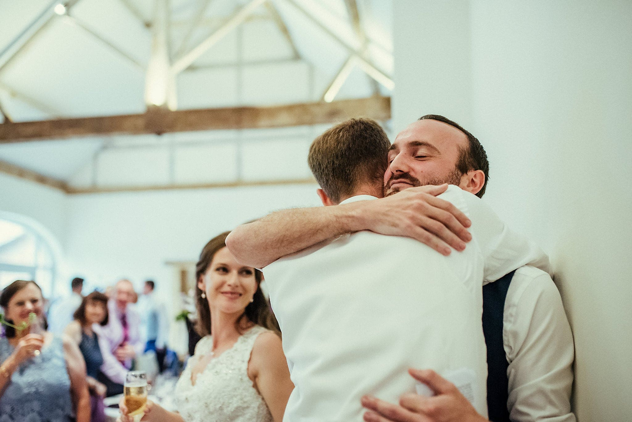 Groom hugging his best man at Dorney Court Barn