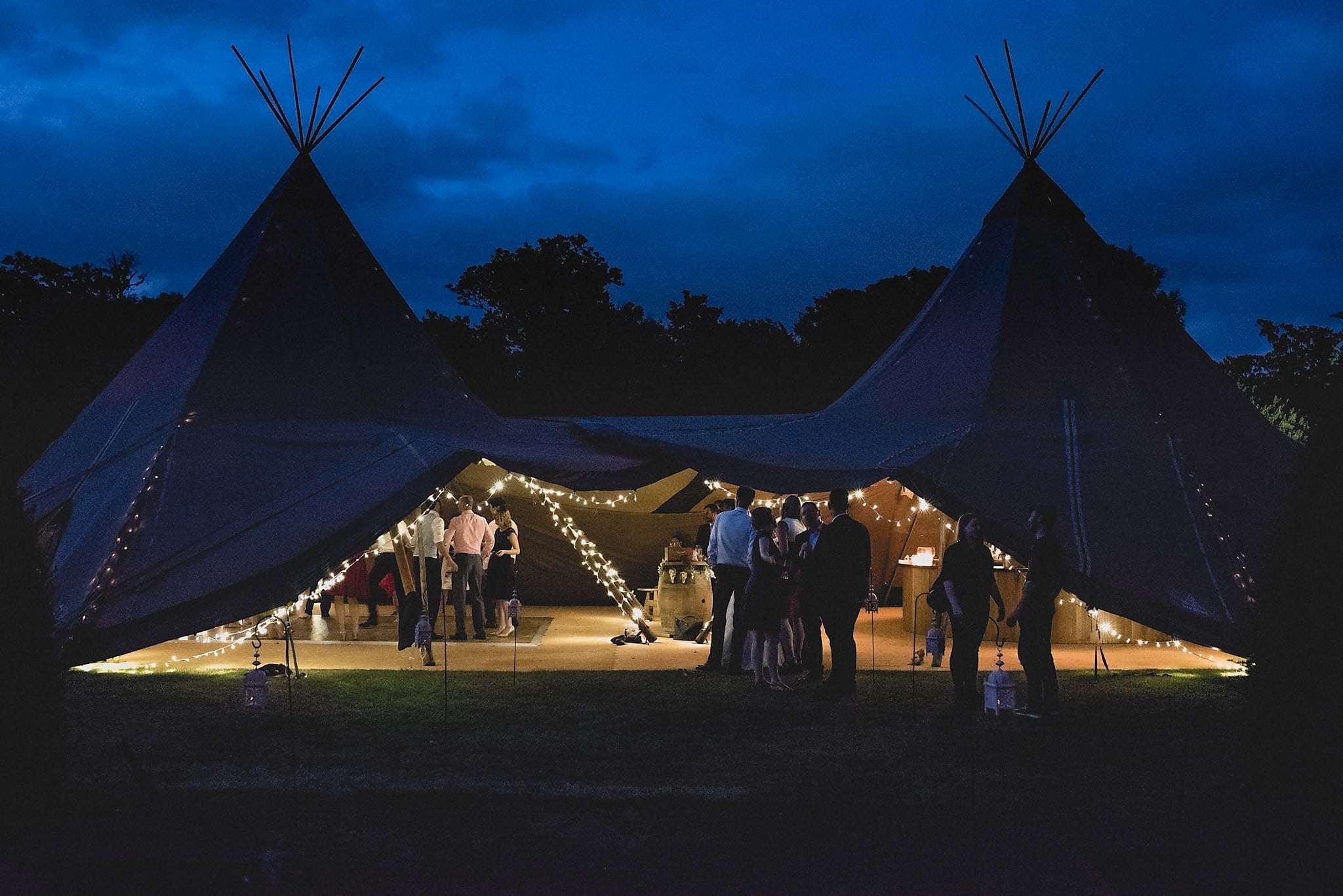 Tipi lit up at night