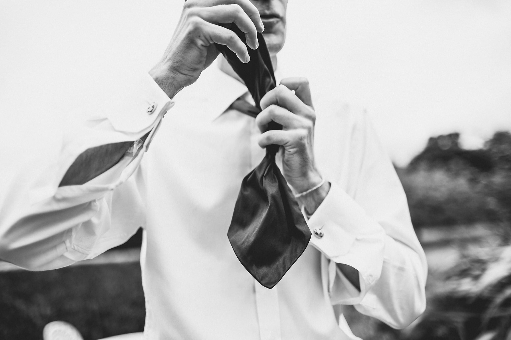 Groom tying his tie
