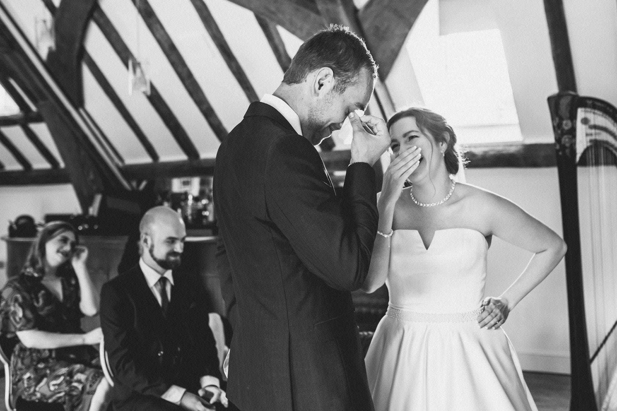 Bride laughs and groom gets emotional during wedding ceremony