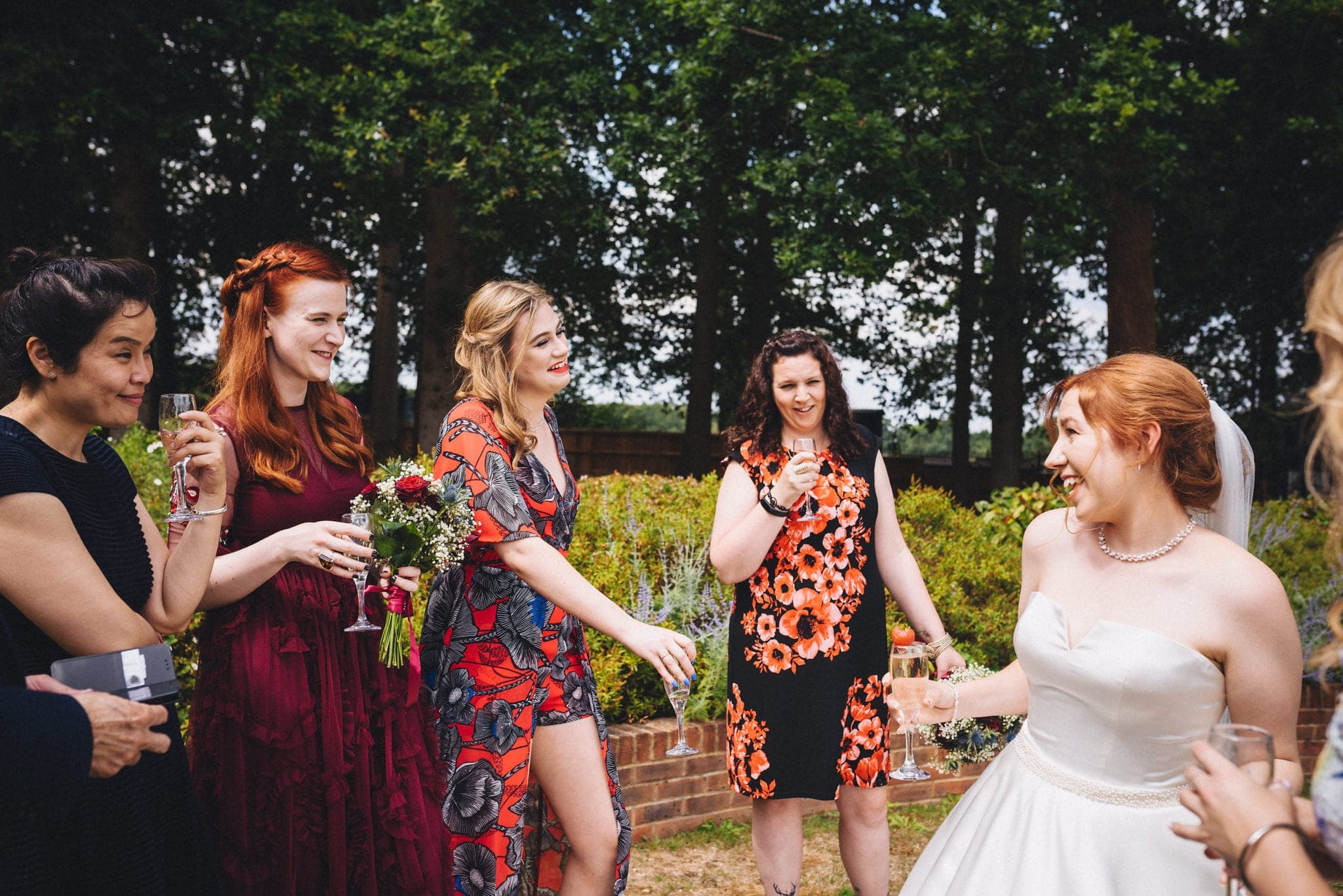 Bride greets friends at her intimate Hever Hotel wedding