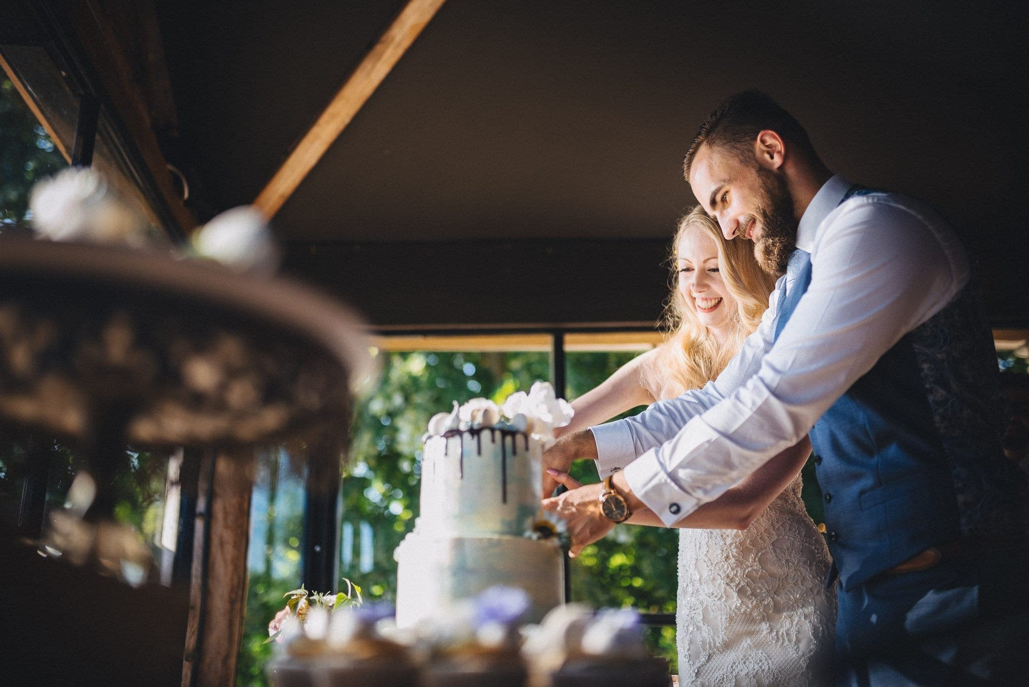 Bride and Groom cutting their wedding cake at their Dewsall Court Wedding