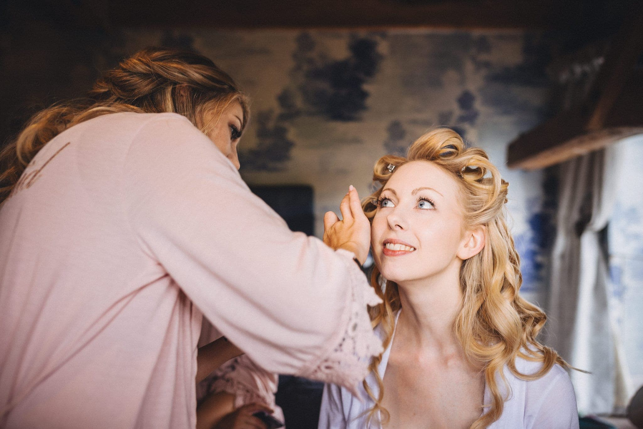 Bride's make up being done for her Dewsall Court Wedding