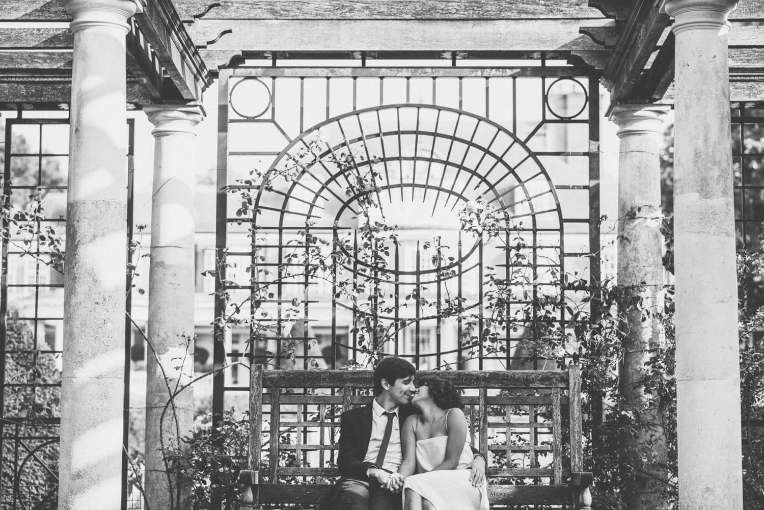 Bride and groom kiss at the Hampstead hill garden and pergola