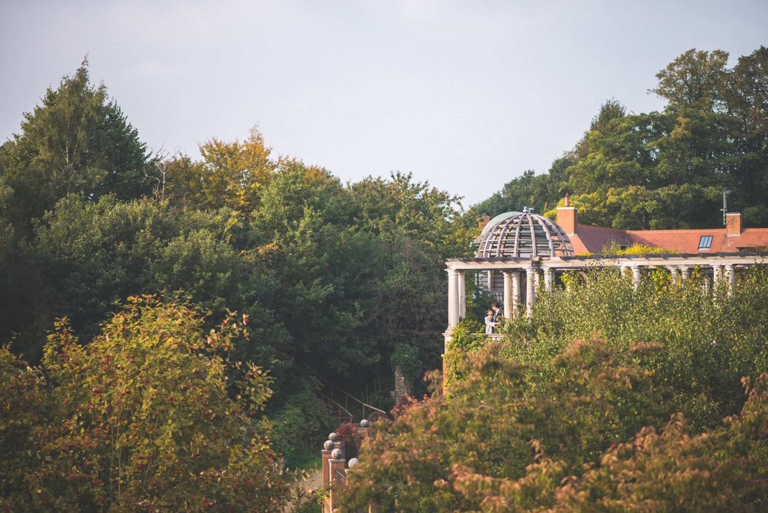 A couple standing in the luxurious wedding venue Hampstead Pergola in London